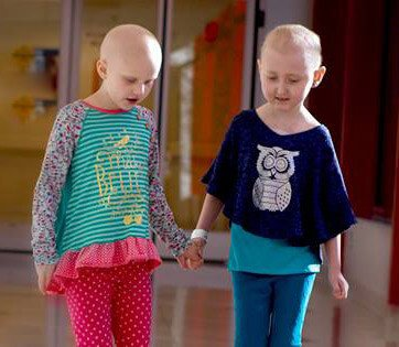 Two girls with cancer walking in the St. Jude Children's Hospital